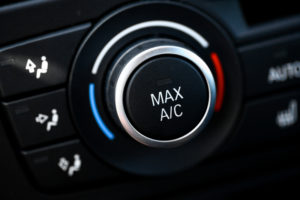 Close-up view of the air conditioning unit buttons in a car.