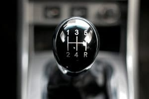 A close-up view of a stick shift in a car.