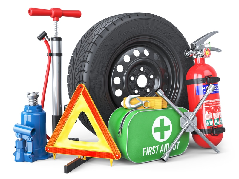 An assortment of car emergency items that drivers should have.
