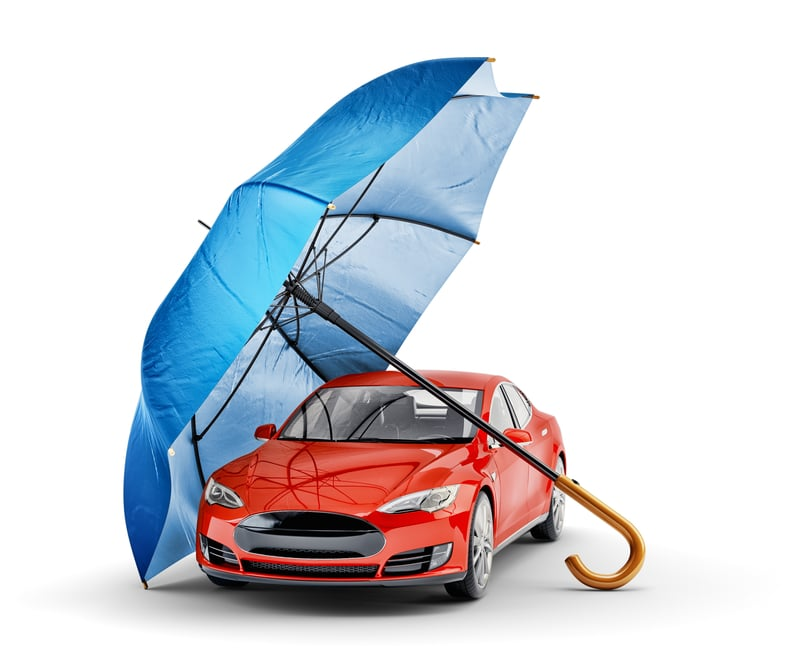 Image of a car being protected by a large umbrella.