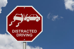 "Image of a stop sign that says ""distracted driving"" instead of ""stop"""