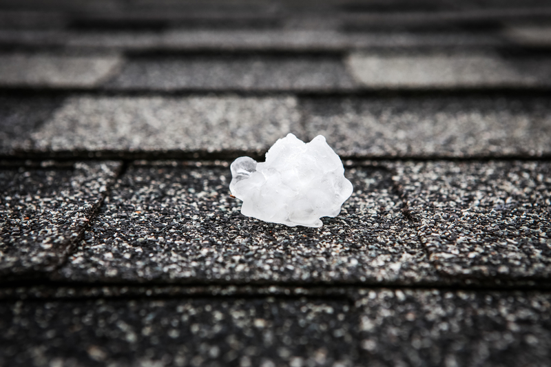 A large hail stone on top of a roof