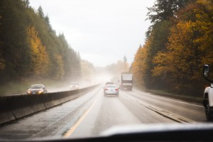 Driver's perspective of wet road and fall scenery in the Pacific Northwest USA.