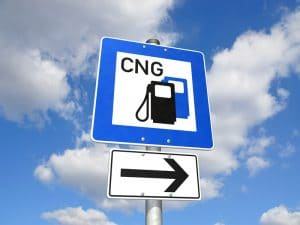 "A sign that says ""CNG"" and has an arrow to signal a natural gas fueling station."