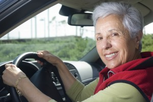 Happy senior woman out for a drive